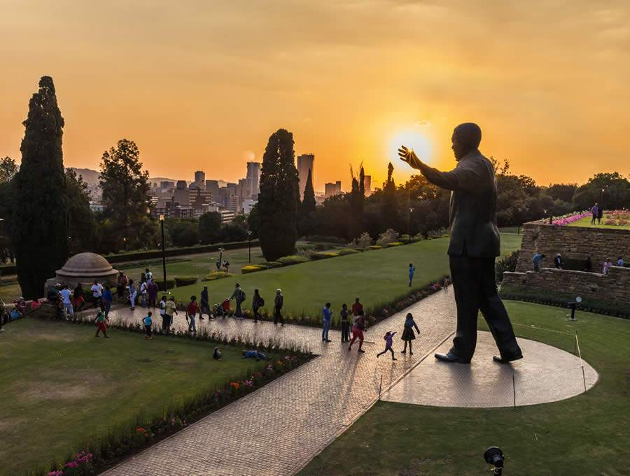 People walking around the Nelson Mandela statue at the Union Buildings_VisitSouthAfrica
